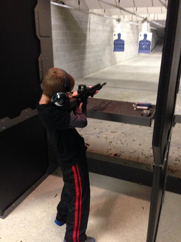 Although this picture of my son shows him holding the gun by himself, I was always holding the barrel when he actually fired the weapon.